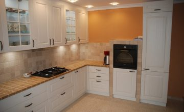 Tiled kitchen after renovation with yellow walls
